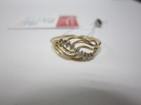 Кольцо с 9-ю бел.кам Золото 585 (14K) вес 1.23 гр.