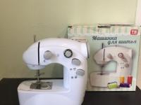 Швейная машинка в коробке