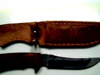 Нож вКс  С коженной ножной с картинкой Волка